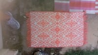 red and white floral textile Austin, 78745