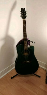 black and brown acoustic guitar 764 km