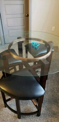 round brown wooden framed glass top table 292 mi