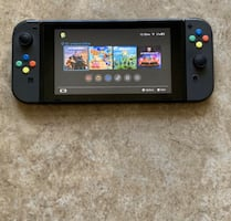 Nintendo Switch (4 Games included)