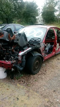 wrecked red car