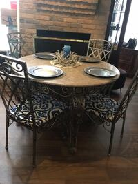 round brown wooden table with four chairs dining set San Antonio, 78232