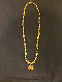 Tigers eye and gold metal necklace Centreville, 20121
