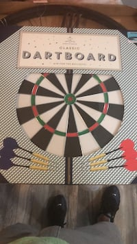 Classic dart board. Never used. Box is still sealed   Amityville, 11701