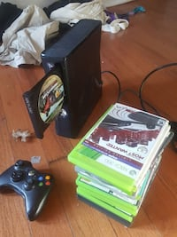 black Xbox 360 with controllers and game cases Falls Church, 22046