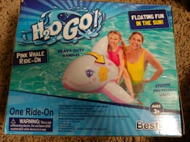 Pink whale ride- on pool float