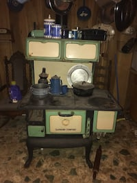 green, black, and white Supreme Comfort potbelly stove Madisonville, 37354