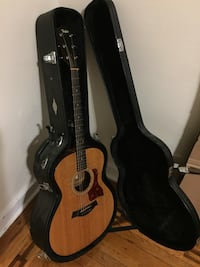 Taylor 214. good condition. hard case with capo. needs new strings