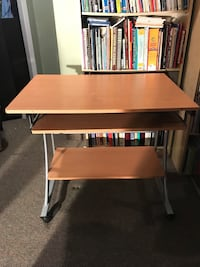 Brown wooden computer desk with gray metal base Mississauga, L4Z 3Z4