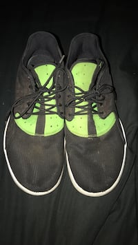 Pair of black-and-green low-top sneakers