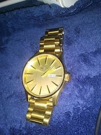 round gold analog watch with gold link bracelet Hurst, 76053