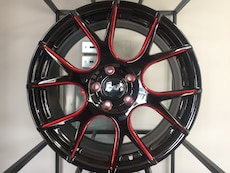 black and red multi-spoke car wheel
