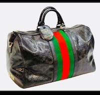 black and green leather tote bag