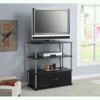 black wooden TV stand with flat screen television Houston, 77092