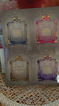 Four clear glass perfume bottles picture