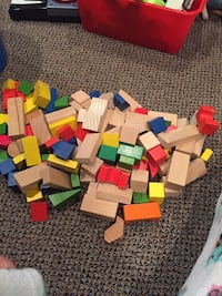 Bucket filled with wooden blocks. It's like two sets wood coloured and then coloured blocks. Only $12! Vaughan, L4J 5L7