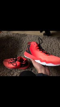 pair of red Nike basketball shoes New Westminster, V3M 5K5