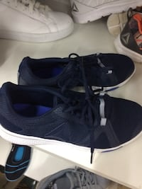 Pair of black-and-blue nike running shoes Brampton, L6T 5J2