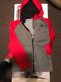 Like new north face boys size large 10-12 zip up dry fit material