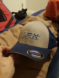 grey and blue Fox baseball cap