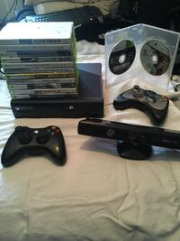 black Xbox 360 console with controller and game cases Spruce Grove, T7X 0G5