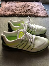 pair of white-and-green Adidas running shoes Charlotte, 28226