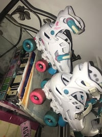 white-and-blue inline skates 165 mi