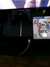 black Sony PS4 console with controller and game cases Monroe, 71201