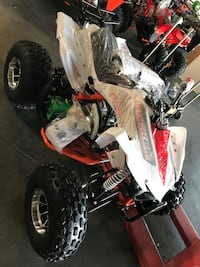 white and red all terrain vehicle Carrollton, 75007