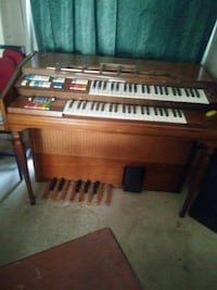 brown wooden framed upright piano Houston, 77036