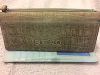 Brown and black leather wallet Calgary, T3J 2W7