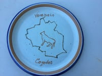 Round white and brown venezuela ceramic plate