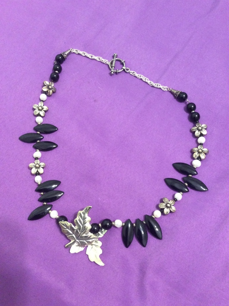 black, silver and white floral necklace