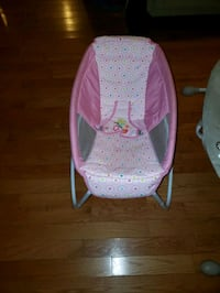 Bedside sleeper and Swing for a baby girl