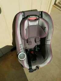 baby's gray and pink car seat