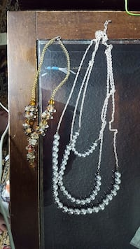 two yellow and gray beaded necklaces