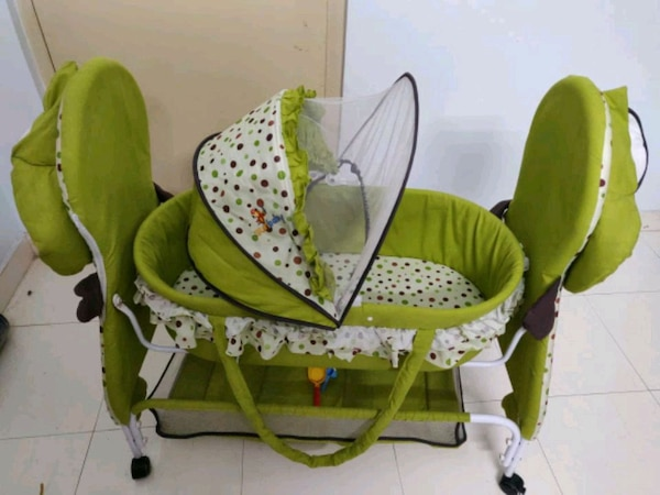 baby's green and white cradle