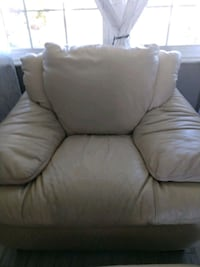 Cream colored leather chair with ottoman. Largo, 33778
