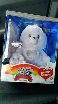 Play Along Care Bears 25th Anniversary Bear with DVD- NEW  Beautiful bear in soft white plush with silver accents to celebrate the 25th Silver Anniversary.  Special rainbow heart tummy symbol.  Silver and white embossed box makes this a great collector or
