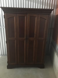Brown wooden 4-door entertainment center