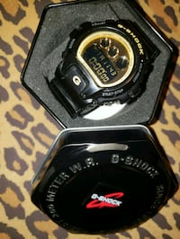 black and gold G-Shock digital watch in box
