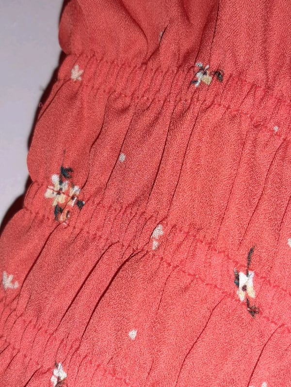 Blouse is orange with cute flowers Brand New with tags size small 5cfd6d1b-6521-4c84-8648-c94c41cfb461