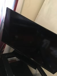 black flat screen TV with remote Decatur, 30032