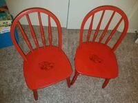 two red wooden windsor chairs