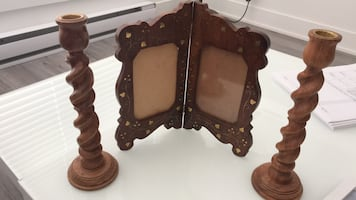 Brown wooden framed wall mirror.