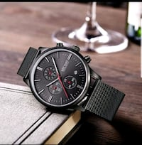 round black chronograph watch with black leather strap Houston, 77063