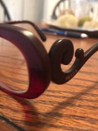 Burgundy Prada Glasses 33 km
