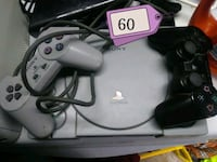 two gray and black Nintendo 64 game controllers Port Richey, 34668
