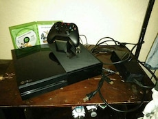 black Xbox One with controller and game case