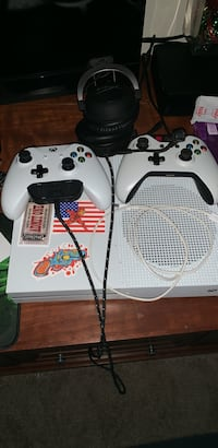 white Xbox One with two controllers 42 km
